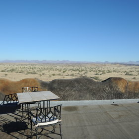 Its location gives spectacular, panoramic views of the surrounding gravel plains and mountain ranges.