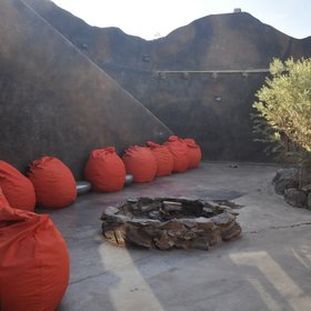 ...offers a fire pit and comfy red beanbags.