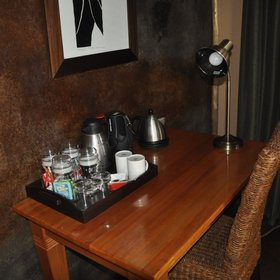 Each room has a desk with tea and coffee equipment...