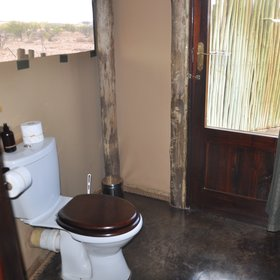 ...and includes a modern, flushing toilet.