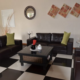 ...is the tastefully decorated lounge with large leather sofas...
