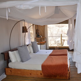 The rooms are very comfortable with mosquito nets around the beds.
