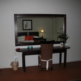with desk and large mirror.