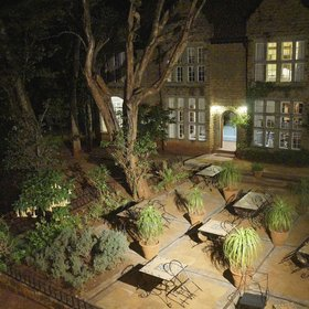 The Garden Manor, which is beautifully lit at night…