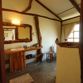 …and also has a roomy, rustic ensuite bathroom.