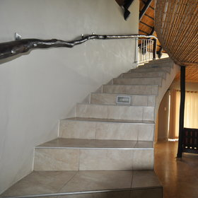 In the Premier Waterhole chalets a staircase leads to…