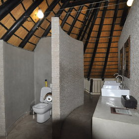 The en-suite bathroom is spacious, with two washbasins…