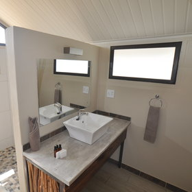 ... each has a large, modern en-suite bathroom with a washbasin...