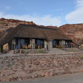 Each thatched unit has four twin rooms...