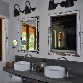 The en-suite bathrooms have twin wash basins, a shower, and separate toilet.
