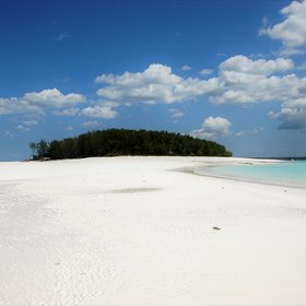 It is surrounded by swathes of white sandy beach...