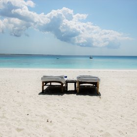 ...and a pair of sun loungers sitting on the pristine beach.