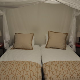 ...and twin beds, complete with mosquito nets.