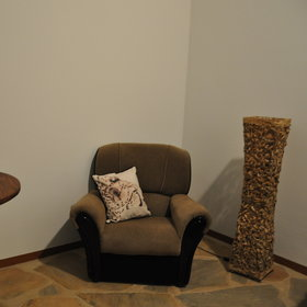 There is also small lounge at the front of the chalet with a sofa and an arm chair...