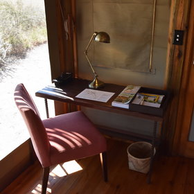 ...comfy chairs, a tea and coffee station, and a writing desk.