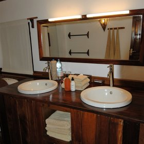 At the back of the tent is a small en-suite bathroom, with twin sinks...