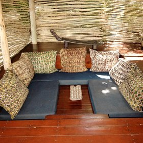 ... and also a sunken lounge, styled with Fundu Lagoon's trademark dark blue cushions.