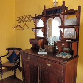 ..using antique furniture and traditional fabrics