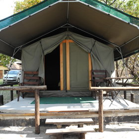 The ten en-suite tents have wooden verandas with camp chairs.