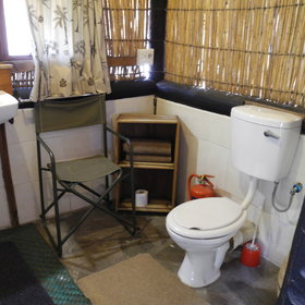 …an en-suite bathroom with a washbasin, flushing toilet…