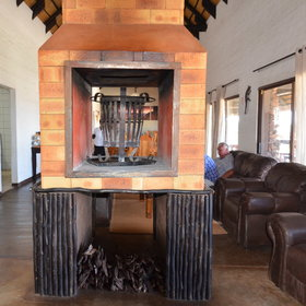 The lounge area has a large central fire and comfortable sofas where you can relax.
