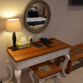 ...with amenities such as a writing desk, phone, hairdryer, DSTV, A/C and safe.