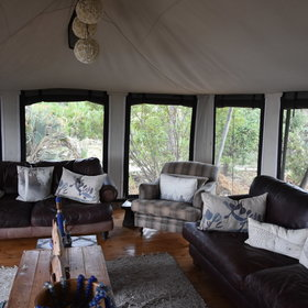 Another tent acts as a lounge area with a few comfy places to relax inside...
