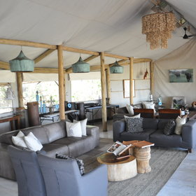 Inside the tented main area is a cozy lounge area, which is open fronted...