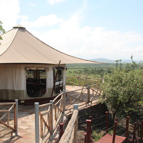 Each of the 12-sided tents at Ol Seki is pitched on a wooden platform on the hillside.