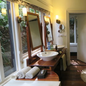 Each cottage has an en-suite bathroom complete with twin sinks, ...