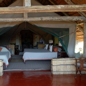 Each of the rooms, or bandas, are furnished with twin or double beds...