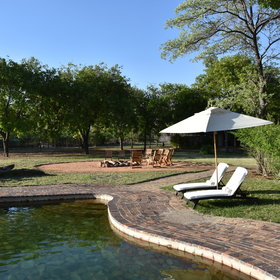 They all overlook well maintained lawns, the pool and fire pit to the waterhole beyond.