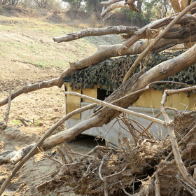 ... with one multi-level hide overlooking a waterhole...
