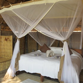 Each has a double or twin bed with a walk-in mosquito net.