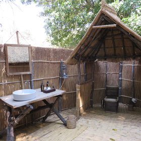 Each chalet has an open-air bathroom with a shower and a flush toilet.