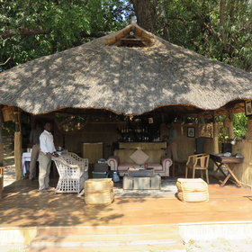 The main area, with a thatched roof and a sand floor, consists of a lounge...