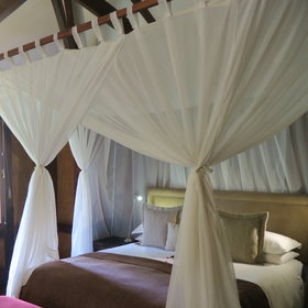 ...complete with canopied beds and fresh white linen...