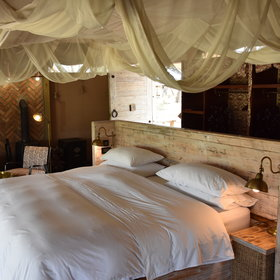 Furnished with twin or double beds made from pallets and curtained by mosquito nets...