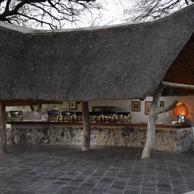 ..with indoor and outdoor seating and an outdoor buffet bar/boma.