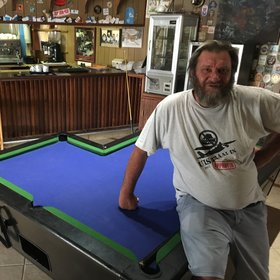 …and a remarkable L-shaped pool table (the owner, Basil Calitz, shows it off).