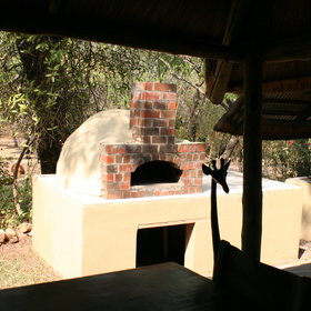 ...with pizzas cooked in the outdoor oven.