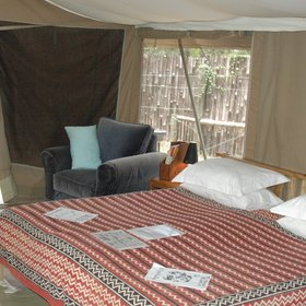 Inside the tents have double or twin beds...