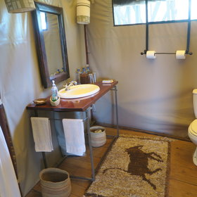 The ensuite bathrooms are simple yet well equipped...