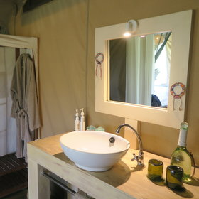 Considering your room is a tent, the bathroom is surprisingly stylish...