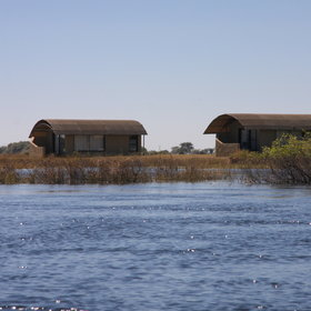 Serondela's chalets sit on the Namibian banks of the Chobe River