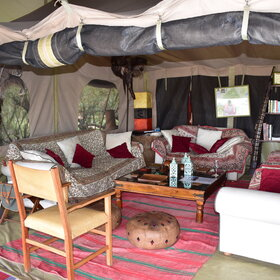 The central lounge tent is furnished with a number of comfortable sofas.