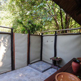 ...and contain a hot and cold shower shaded by the surrounding bush...