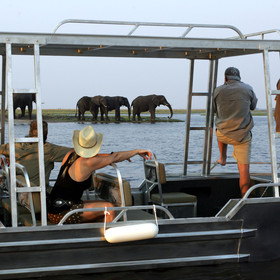 Activities include 4WD game drives, fishing and boat trips in a smaller outboard boat