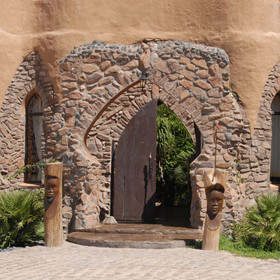 With its teracotta walls and arches...