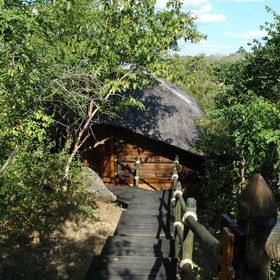 The rooms at the Mivumo River Lodge are hidden in the forest...